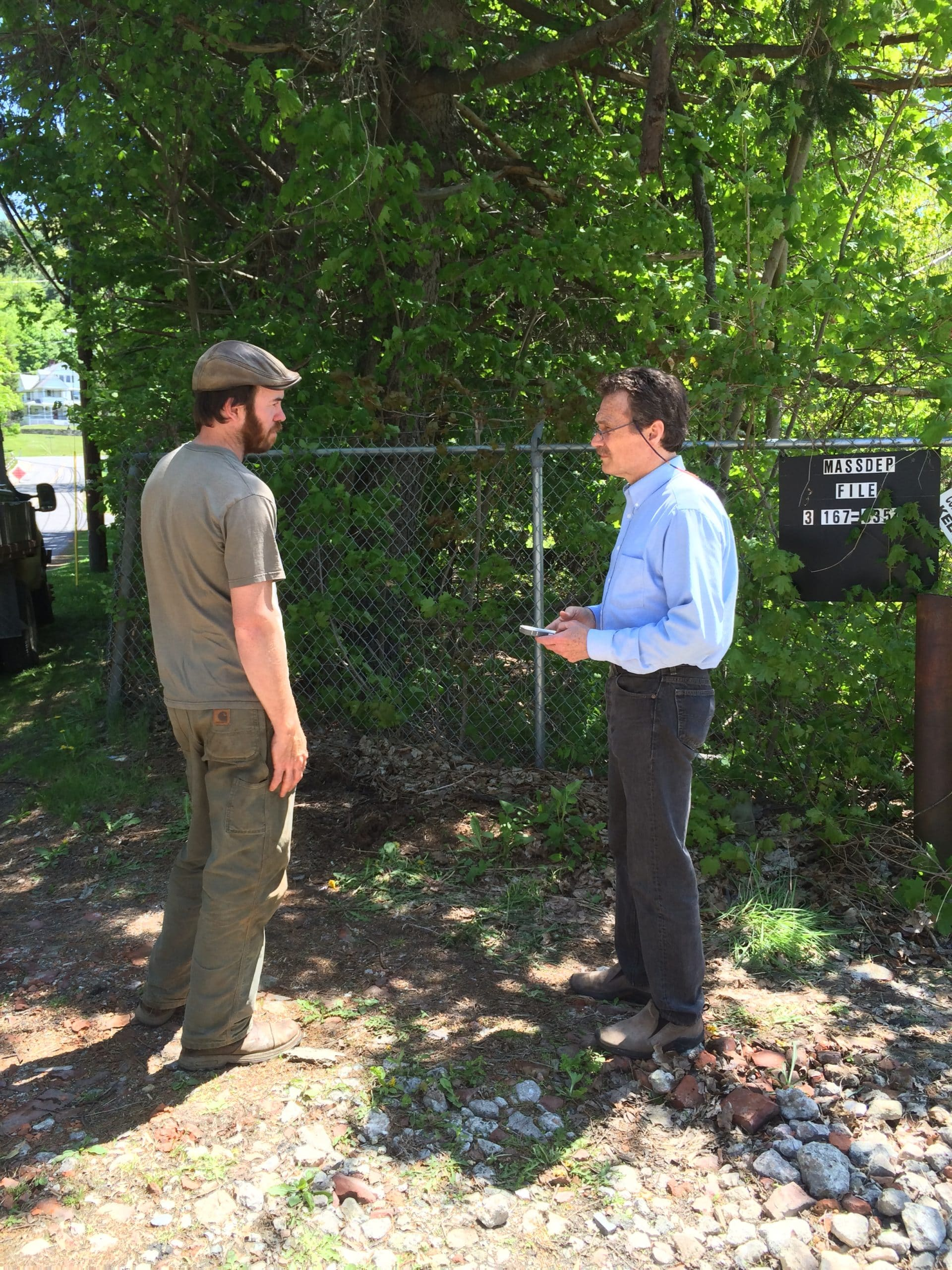 Will Conklin, who will recycle trees taken from the Log Homes site, and the CDC's Tim Geller.