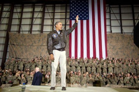 President Obama saluting troops in Afghanistan.