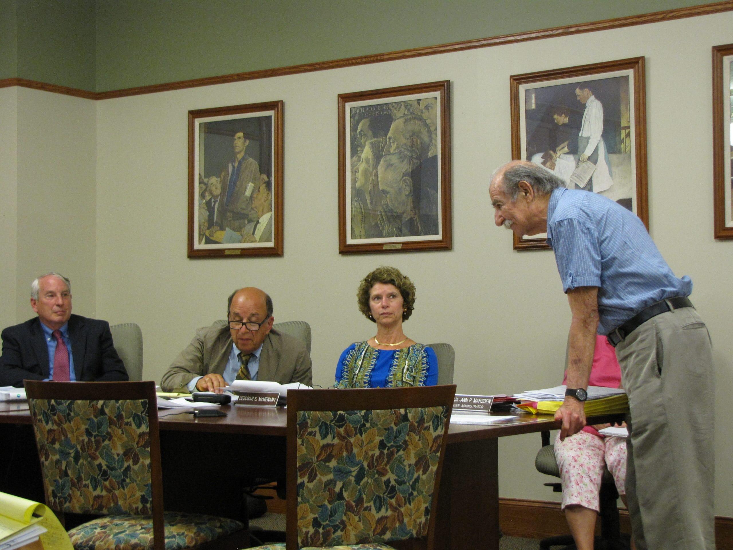 Eugene Talbot addresses Board of Selectmen: from left, Charles Gillett, Stephen Shatz, and Deborah McNemany.