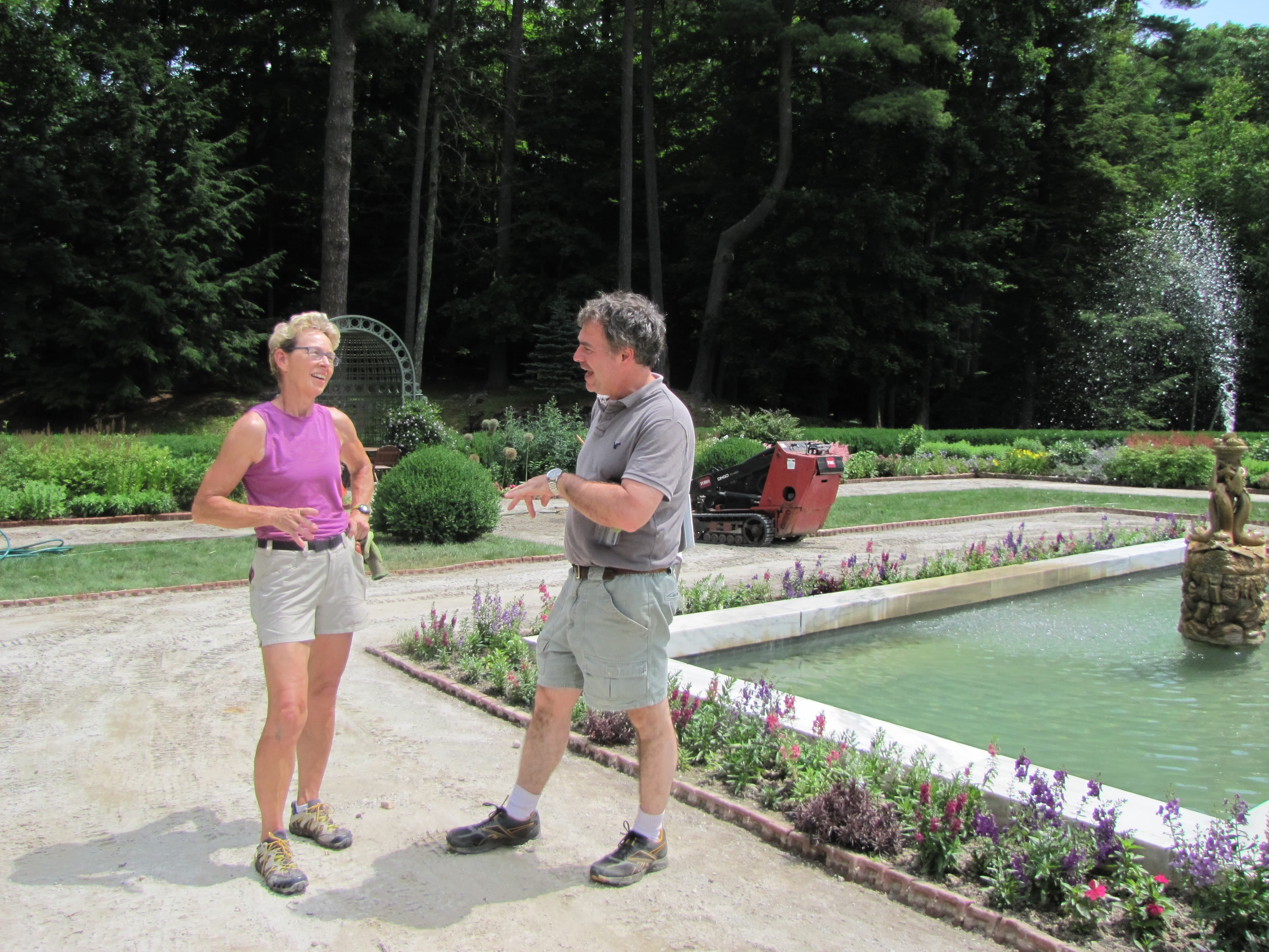 At left, Laura Walton, head gardener, discusses the repair of the gardens with facilities director Ross Jolly.