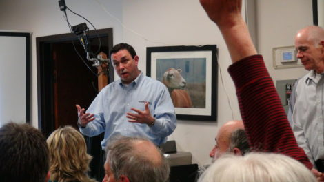 Kinder Morgan public relations director Allen Fore addresses crowded meeting in Montague.