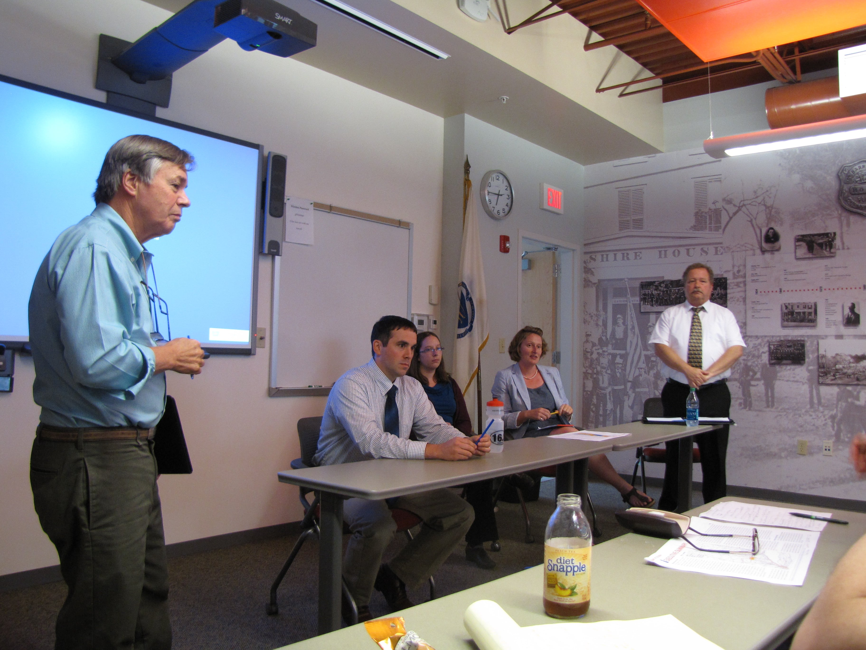 Housatonic Railroad Vice President Colin Pease addresses public session of rail station locations.