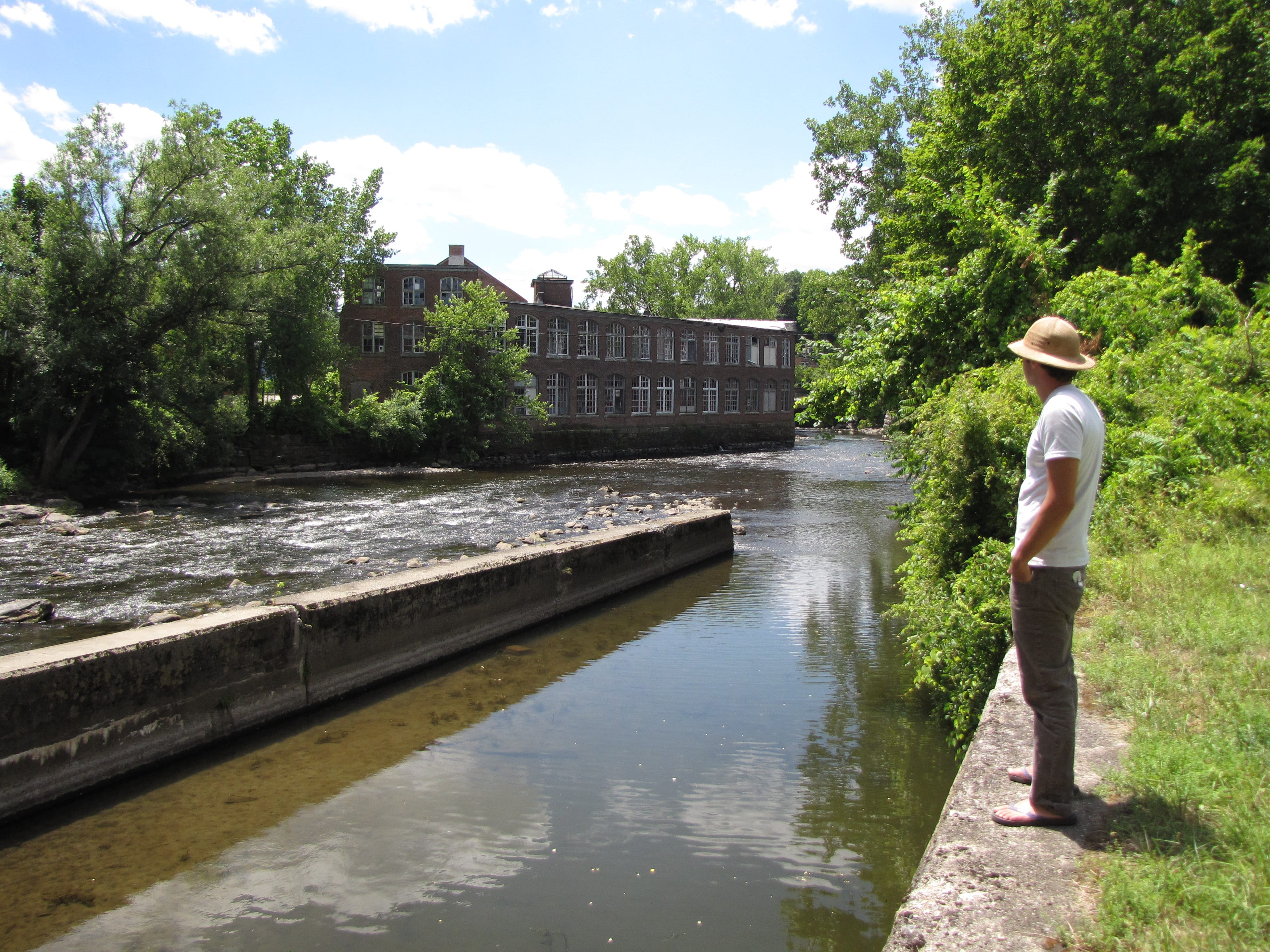 Ethan Culleton along the banks of the Housatonic River across from the mill complex, where he envisions the trail network to Flag Rock beginning. Photo: David Scribner