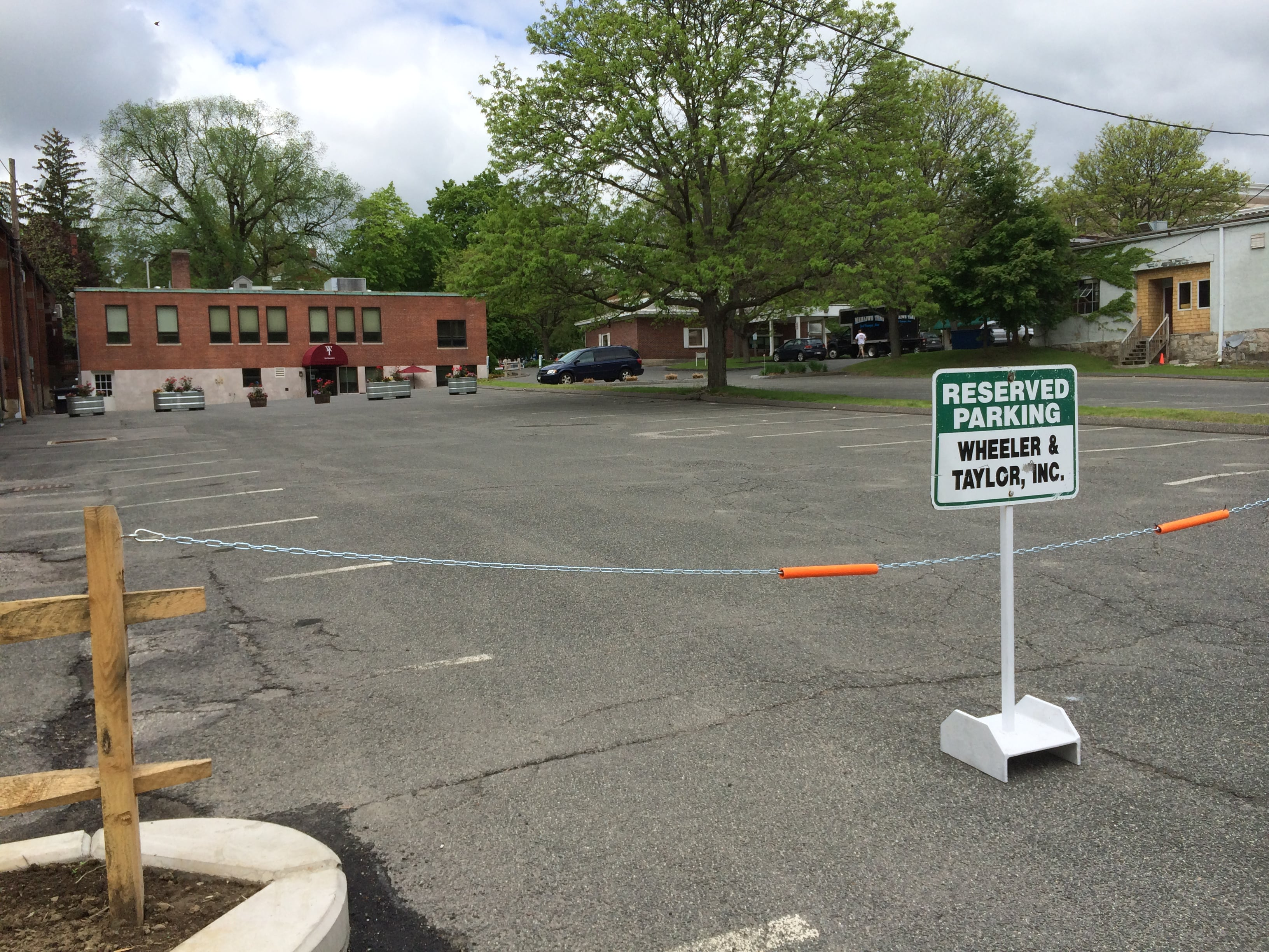The empty and chained-off Wheeler and Taylor parking lot on a weekend, as seen from the Berkshire Co-op parking lot.