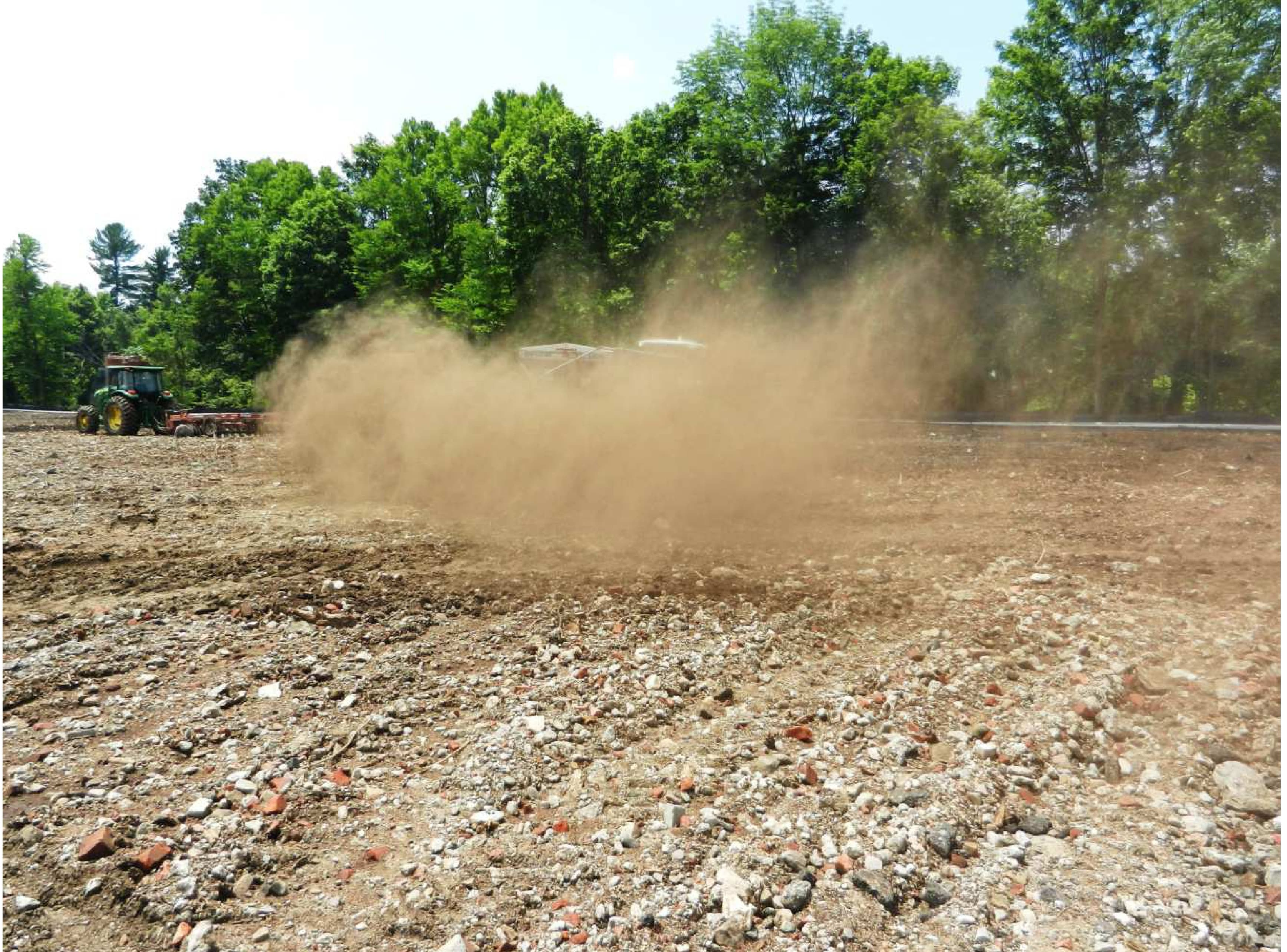 A cloud of factor dust follows the application of the bioremediation material when it was applied in July.