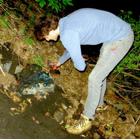 The author digging for slag glass.