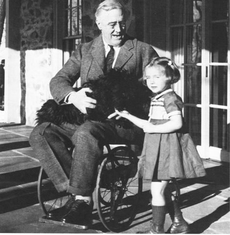 President Franklin Delano Roosevelt in a wheelchair.