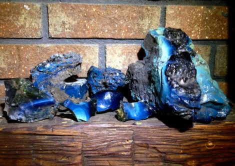 slag glass collected from digs arrayed on the author's mantel.