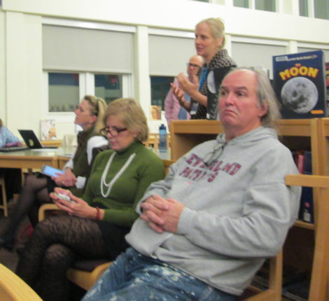 High school renovation opponents Karen Christiansen (in green sweater) and Patrick Fennell together at November 6 School Committee meeting, while Muddy Brook Elementary School Principal Mary Berle addresses the session. Photo: Heather Bellow