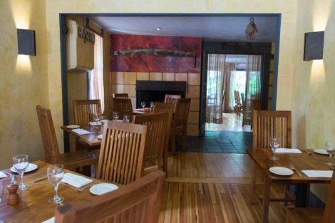 The John Andrews dining room, characterizing the restaurant's elegant farmhouse ambience.