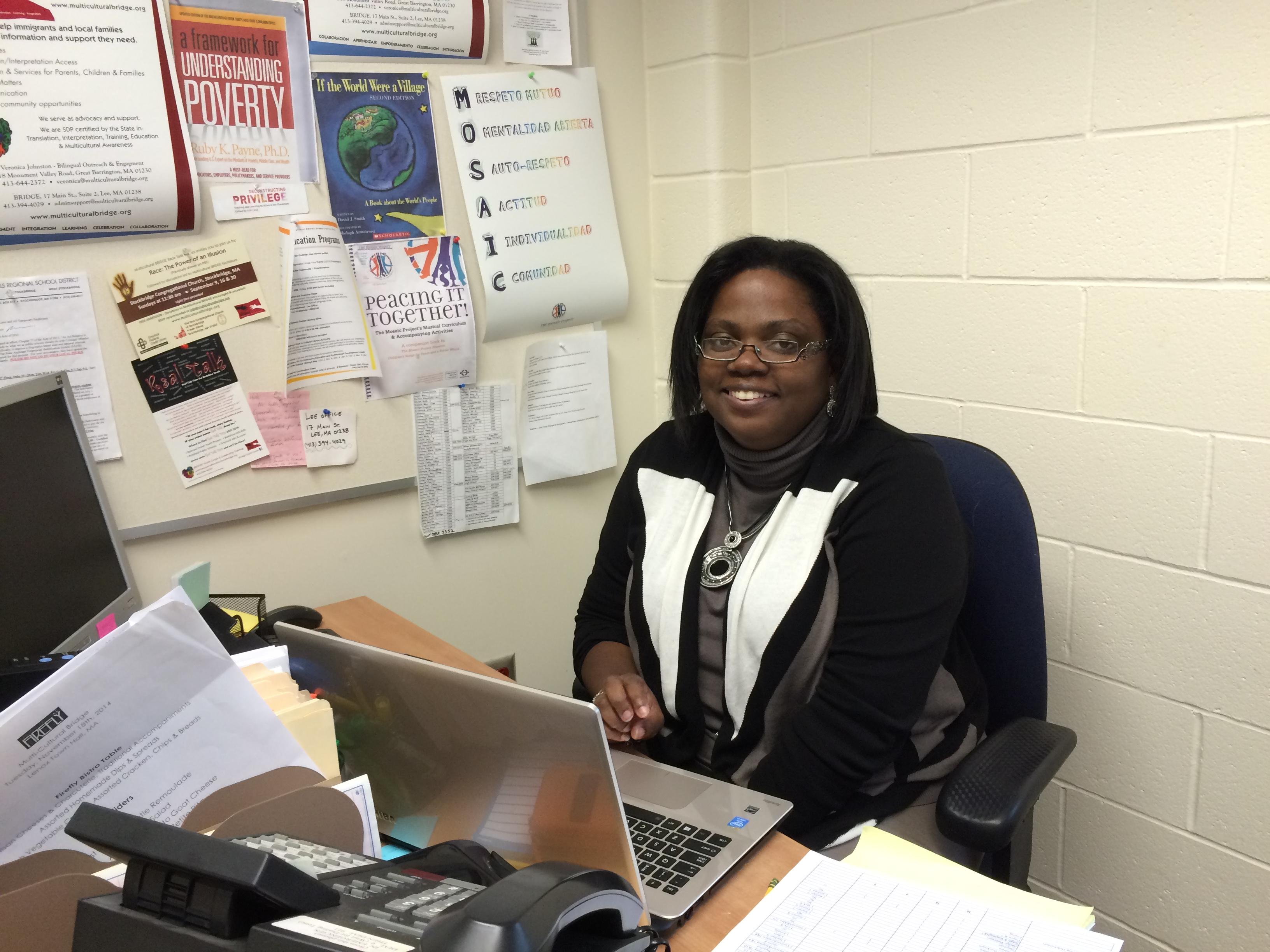 Multicultural BRIDGE's director Gwen Van Sant in her office at Muddy Brook Regional Elementary School.