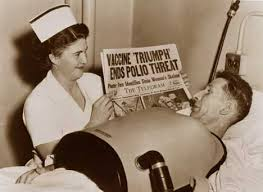 A polio victim in 1952 in an iron lung learning of successful creation of a polio vaccine.