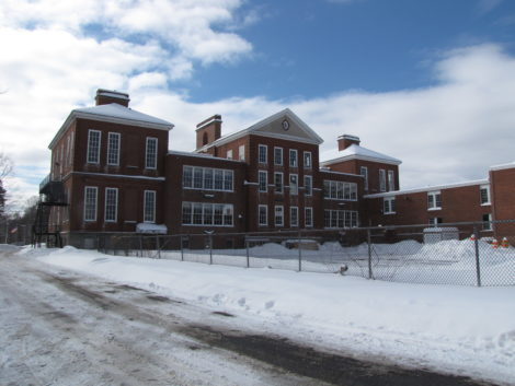 The back of Searles Middle School complex, showing annex at right and the roof of the gymnasium, upper right.