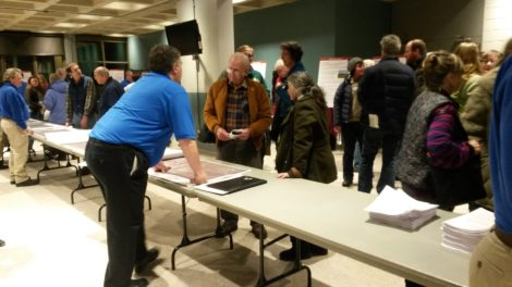 An information table during the Kinder Morgan open house at Berkshire Community College. Kinder Morgan representatives are in blue.