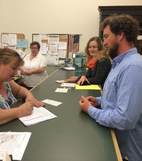 Incumbent Sean Stanton being sworn in by Town Clerk Marie Ryan.