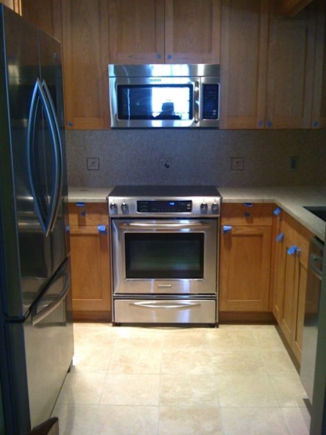 The condo kitchen with new stainless steel appliances.