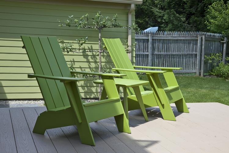 Green Adirondack chairs. Photo: Peter Vanderwarker