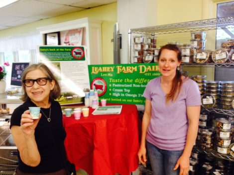 Jen Leahey, right, of Leahey Farm at Berkshire Organics open house. Susan Geller of Pittsfield is sampling the milk.