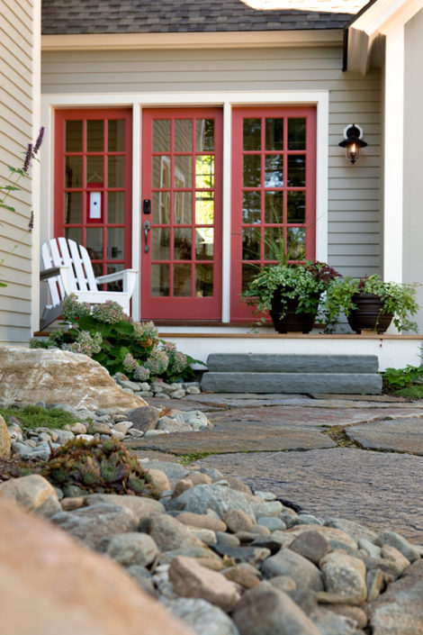 Mudroom entrance deck with undulating river stone beds along Goshen Stone walk, Hydrangea 'Pinky Winky' along deck corner. This is oriented to the north so it stays pretty shady. Photo: Michael Lavin Flower