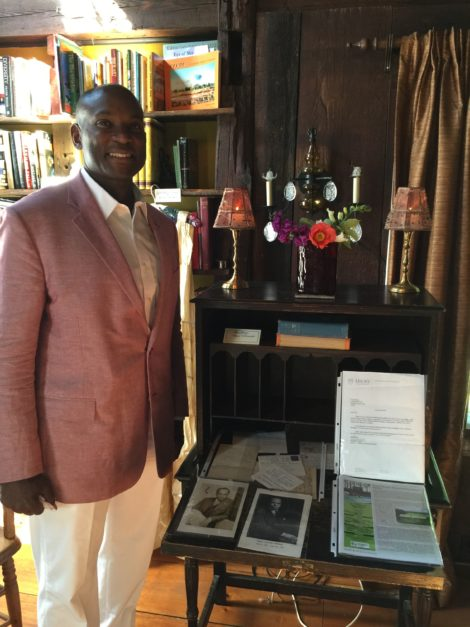 Rufus Jones next to the James Weldon Johnson's desk in his home at Five Acres.