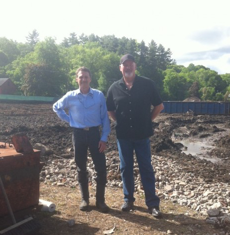 CDC Exectuive Director Tim Geller, left, and BioTech Restorations President Christopher Young, on Log Homes site during last year's rehabilitation of the parcel.