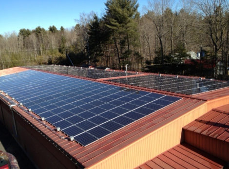 A rooftop solar installation on the Caligari Hardware store in Lenox.