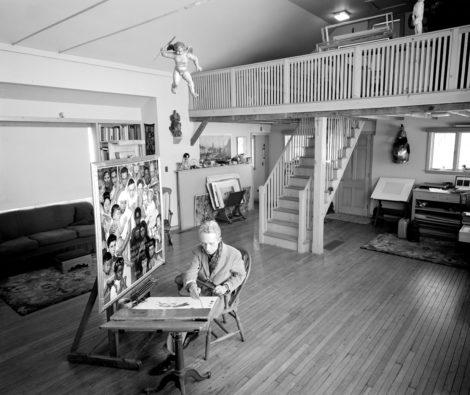 Norman Rockwell working on Golden Rule in his South Street, Stockbridge, Massachusetts, studio, 1960. Photo by Bill Scovill