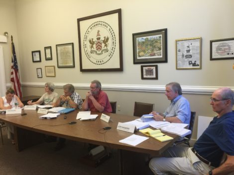 Zoning Board of Appeals listens to Claudia Shapiro: from left, Kathleen Kotleski, Vice Chair Carolyn Ivory, Chairman Ronald Majdalany, John Katz and Donald Hagberg. ZBA member Michael Wise recused himself because he is in the Rotary Club, which sponsors the Bike n' Fly.