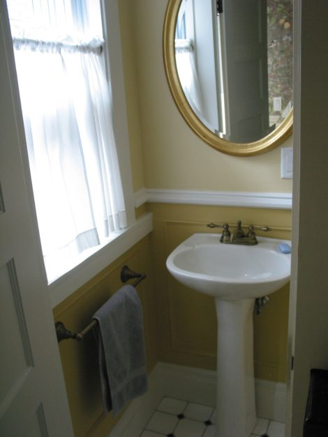 A powder room that was made to fit under the stairs. Photo: Erica Fay