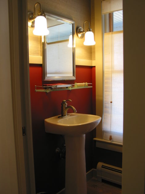 A powder room fitted into redesigned unused bedroom. Photo: Erica Fay