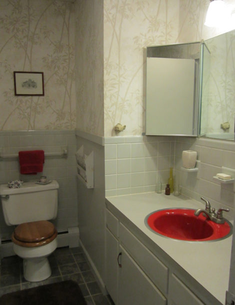 A full bath sacrifices counter space to add a stall shower to a powder room.  Photo: Erica Fay
