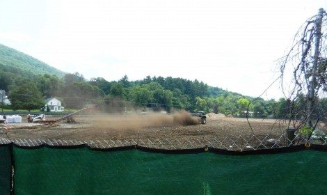 "Last summer, dust rises from the tractor and disc infusing the soil with the BioTech Restorations ""factor."""