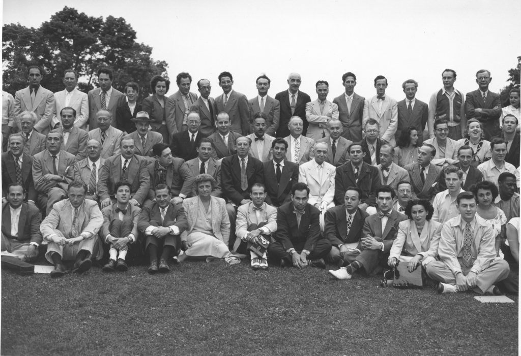 BMC class picture 1948:  First row: Lukas Foss third from left; second row Aaron Copland sixth from left and Leonard Bernstein and Serge Koussevitzky (in white suit) to Copland's left.