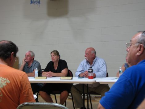 Selectmen (left to right) Donald Hawley, Roberta Sarnacki and William Hiller listening to Larry Gould explain the turbine project.
