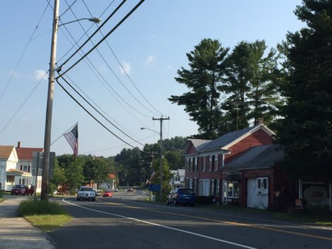 The town of Otis intends to provide each household with a high-speed Internet connection, utilizing fiber optic cable strung from poles such as these on Route 8.