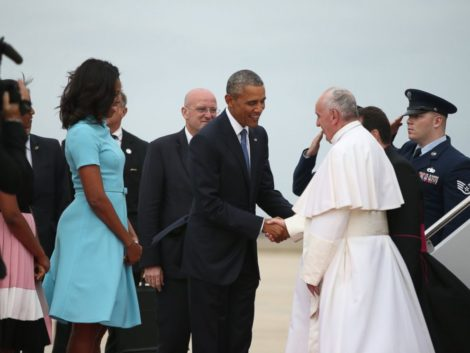President Barack Obama and First Lady Michelle Obama welcome Pope Francis upon his arrival at Andrews Air Force Base outside Washington, D.C.
