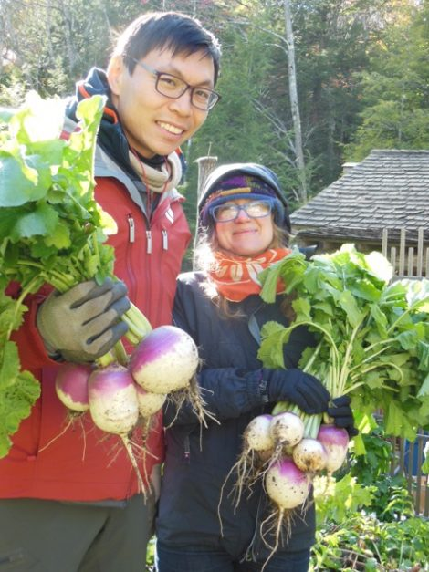 Geo Kao and Kelsy Waggaman with bouquets of Turtle Tree Seed Zuercher purple top turnips. Photo by Mackenzie Waggaman, October 18, 2015