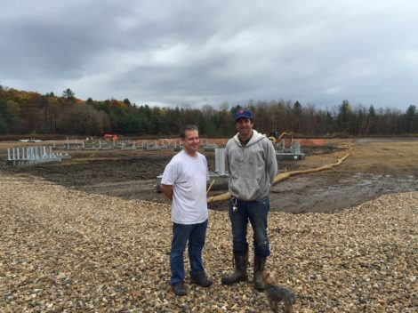 Berkshire Hills Regional School District facilities manager Rick Soule, left, and solar energy entrepreneur Kirt Maryland at the Solar 1 site in Housatonic.