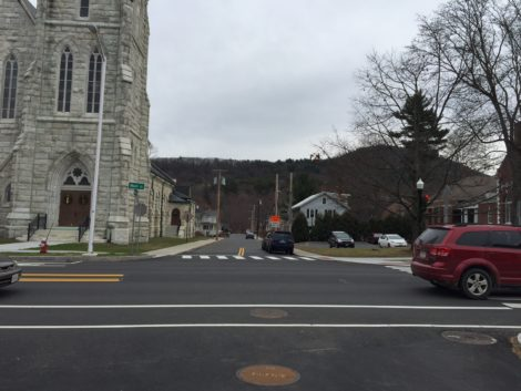 Across Main Street from Ried Cleaners is Dresser Street. At left, St. Peter's Church; at right, the Mason Library. Dresser Street leads straight to the Housatonic River.