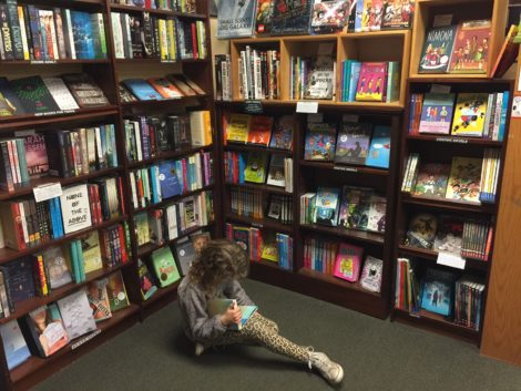 A young customer in the children/young adult section.