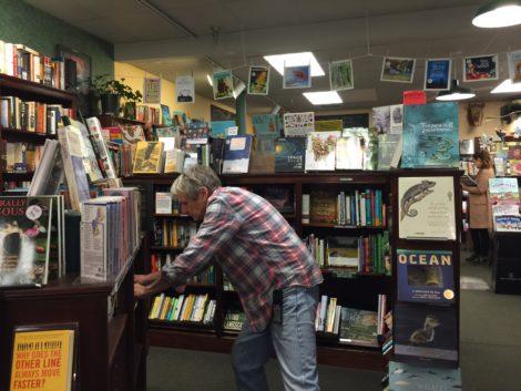 Eric Wilska, refilling The Bookloft shelves. Photo: Heather Bellow