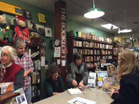 Bookloft staff attend to a customer's new purchase.