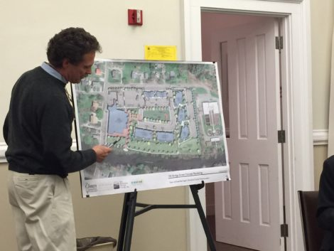 At a Planning Board meeting CDC Executive Director Tim Geller explains the features of the 100 Bridge Street development.