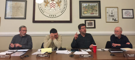 Selectboard member Ed Abrahams, gesturing, expressed concern that the affordable housing units would be situated near the adjacent sewage treatment plant, as fellow board members listed. From left, Stephen Bannon, Dan Bailly and Bill Cooke. Photo: Heather Bellow