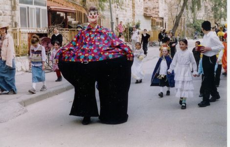 Costumes adorn celebrants during a Purim celebration on the streets of Jerusalem.
