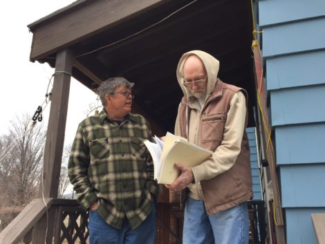 Tim Gray and HRI President Dave Gibbs at his house in the Lakewood District of Pittsfield, looking over the 'scary file.' Photo: Heather Bellow