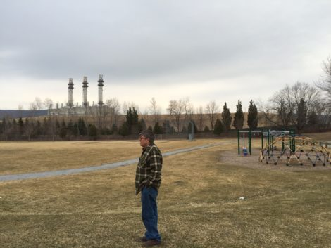 Tim Gray at the Allendale School playground. The ridge rising beyond the playground is Hill 78, the huge mound that had contained toxic waste from GE's operations and where GE was allowed to deposit PCB's dredged from the river in Pittsfield. Photo: Heather Bellow