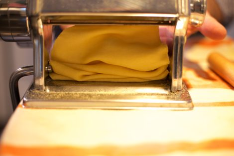 Pasta dough folding under the Atlas machine.