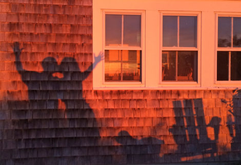 A kiss in the sunset at our new small cottage.