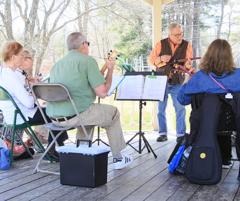 Paul Edelman, leading the Berkshire Ukulele Band's Sunday Strummers, in the gazebo behind Town Hall. Photo: David Edwards.